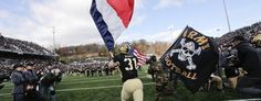 Army takes the field with American and French flags. (AP)