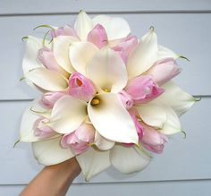 "A bouquet that resembles a Glamelia:  ""This incredible bouquet almost looks like a glamelia, but it's a mix of white calla lilies and pink tulips. ..."""