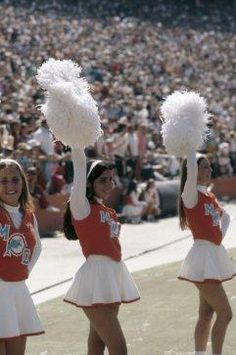1972 Cheerleaders for the Miami Dolphins on the sidelines during a game against the New England Patriots on November 1972 at the Orange Bowl in Miami, Florida. (Photo by: Kidwiler Collection/Diamond Images/Getty Images) Cheerleading Cheers, Cheerleading Uniforms, Cheer Stunts, Cheer Uniforms, All Cheerleaders Die, Dolphins Cheerleaders, Softball Senior Pictures, Senior Guys, Senior Photos