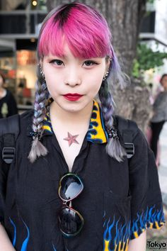 """Kathy is a friendly college student w/ lots of ear piercings who we met in Harajuku. Her look features pink bangs, purple braids, a lot of flame-print & Cute To The Core brand shoes. Check all of her snaps!"""
