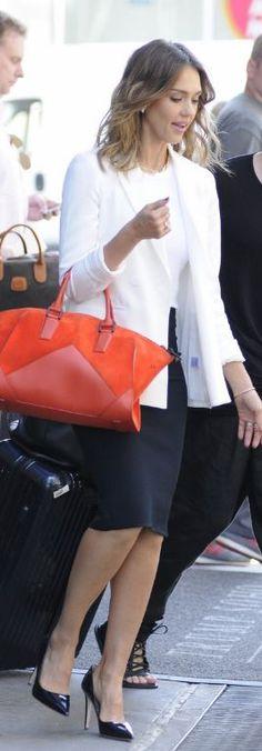 Jessica Alba: Jacket and skirt – Theory  Shirt – A.L.C.  Purse – Narciso Rodriguez