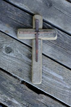 This rustic wooden cross is a handmade original design. It is made from reclaimed barn wood from the Pacific Northwest. On the face of the cross is another cross made from antique nails dating from the 1800s. The approximate dimensions are 5 wide by 9 long and 3/4 deep. The dimensions of the antique nails are 6 long by 4 wide.  This is a finished piece of art ready to be enjoyed in your home upon receipt. No two crosses are identical due to the natural finish and age of the wood and nails…