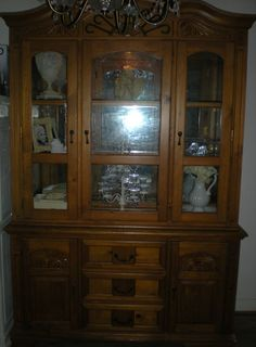 Large ornate display cabinet with glass top display unit, nirrored back and backlighting, Ornate carved woodwork. Available for sale