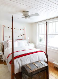 The owner of this Wisconsin home sewed her own bed shams from Swedish tea towels.   - HouseBeautiful.com