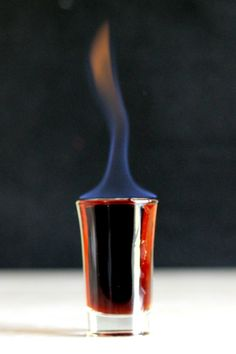 Eliminator drink recipe: light this shot on fire before serving. Make sure guests blow it out before drinking! http://mixthatdrink.com/eliminator/