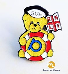 Fund raising bear badge for the RNLI, golden glitter enamel fur.