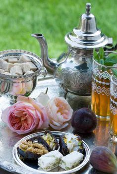 Serving tea with walnut filled dates and Persian pistachio nougats called Gaz   چای به همراه خرماگردویی و گز
