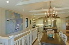 Love the white beams and white ceiling in this coastal style home. House of Turquoise: Regan Baker Design