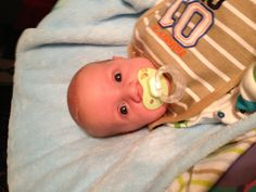 Our blue eyed pacifier baby!!