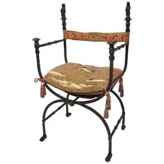 Wrought Iron Savonarola Chair | From a unique collection of antique and modern chairs at https://www.1stdibs.com/furniture/seating/chairs/
