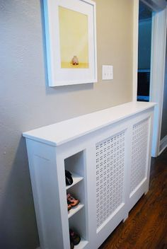 Wondering how to build a DIY radiator cover? Combine storage and function with this DIY radiator cover in a narrow entry way. Storage Heater Covers, Modern Radiator Cover, Home Radiators, Küchen Design, Interior Design, Cubby Storage, Dining Room Walls, Hallway Decorating, Decoration