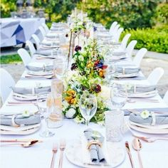 Fashion designer Rachel Pally throws outdoor dinner party in Hollywood Hills with casual modern table design of light greys, mixed metals and meadow flowers