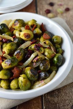 Roasted Brussels spouts with bacon, caramelized onions, pistachios and dried cranberries. Favorite holiday side dish!