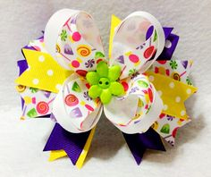 4.5 Inch Boutique Hair Bow Spiked Pinwheel Resin Flower Embellishment. Candy Print and Polka Dot Grosgrain Ribbon This spring hair bow, is a bright, lightweight hair bow perfect for any little girl, t