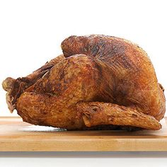 Revamp the standard turkey by coating it in Cajun spices. Be cautious when lowering the bird into the fryer.
