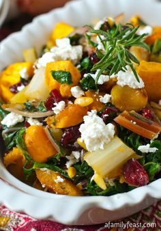 Roasted Butternut Squash and Swiss Chard with roasted garlic, caramelized onion, pine nuts and dried cranberries.... crumbled goat cheese