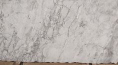 "This is ""White Fantasy"" Granite, we used this on our island because marble isn't recommended for the kitchen. Love it because it resembles Carrera Marble. -S"