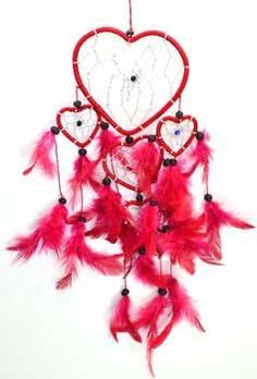 """A heartfelt take on the traditional dream catcher comprised a large central heart shaped dream catcher with smaller versions hanging from the central heart. Large heart is 4 1/2"""" and the whole dream c"""
