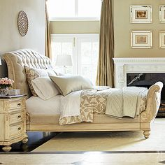 Sleigh bed with button-tufted upholstery and turned bun feet.   Product: King bedConstruction Material: Wood and fabr...