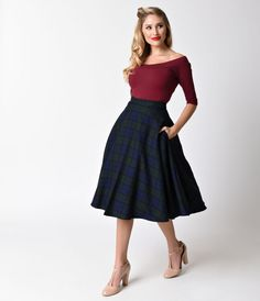 Pretty in plaid, darling! A vintage inspired swing skirt from Hell Bunny, the Doralee skirt is a magnificent navy blue and emerald green plaid wardrobe staple! Crafted in a retro inspired silhouette and featuring a flattering high waist design and back ce