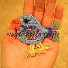 BLUE BIRD. Loomed by Nicole Rocco on the Rainbow Loom. Made with the HERRING GULL design by Jaclyn Lecaros. Pictorial available.