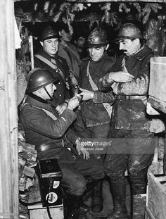 French corporal receiving his 'pinard' (red wine ration) in artillery dugout near the Maginot Line.