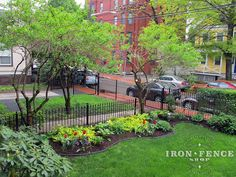 Wrought iron fence and gates (3ft and 4ft tall) used to accent a beautiful front yard landscape