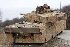 Leopard 2 A7+ with 'Barracuda' mobile multi-spectral camouflage.
