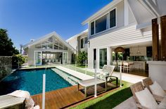 Pool house next to pool and kitchen opening to pool as well. Southport Residence by BGD Architects 02 Outdoor Areas, Outdoor Rooms, Outdoor Living, Cabana, Weatherboard House, Queenslander, Facade House, House Exteriors, Pool Houses