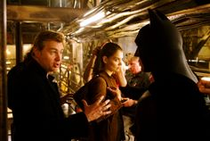 Director Christopher Nolan, Katie Holmes and Christian Bale on the set of Batman Begins (2005)