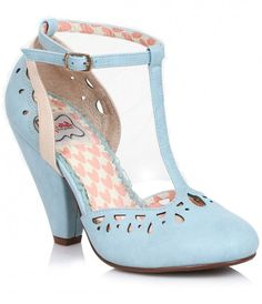 """We've found the way to stand out, dames! Meet Elsie, a set of elegant powder blue pumps crafted from man-made leatherette, featuring a closed toe and 4"""" cone heel with enough lift for any leading lady! An adjustable T-strap provides a secure fit with gori"""