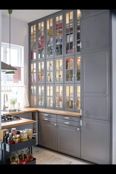 AKURUM wall cabinets with glass doors look fantastic in this kitchen Office cabinets???