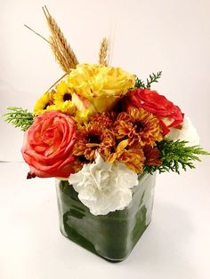 Small but lavish floral arrangement, full of orange, yellow and white colors perfect for Fall theme.
