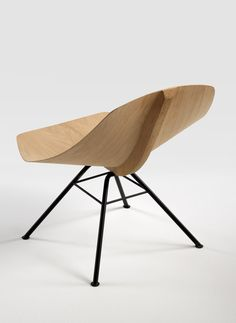 Wing Chair, Werner Aisslinger for LEMA  What an amazing contour from yet another piece of Magical Wood