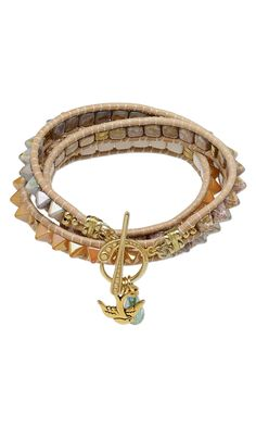 Jewelry Design - Lashed Wrap Bracelet with Czech Pressed Glass Spacers, TierraCast® Antiqued Gold-Plated Pewter Charm and Celestial Crystal® Bead - Fire Mountain Gems and Beads