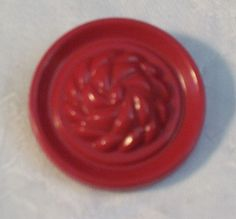 Red Plastic Colt ? Button    1 and 1/8  inch