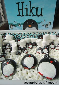 Penguin story stones to act out the story of Hiku. Easy to make craft for a penguin sensory bin.  Adventures of Adam Hiku toddler penguin sensory play