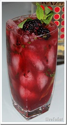Blackberry Mojito       16 mint leaves  12 fresh blackberries  1 tsp sugar  3 oz Baccardi razz (any white rum will do)  1 oz lime juice  club soda  crushed ice    Method    In a pitcher, place the mint leaves, blackberries and sugar and muddle well. Add the rum and lime juice and stir well to combine.  Fill highball glasses with crushed ice and strain the drink into the glasses. Top it with club soda. Garnish with mint leaves and blackberries.