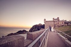 Bride and groom with sunset at Durltson Castle weddign in Dorset by one thousand words wedding photographers www.onethousandwords.co.uk