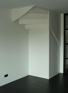 The space under the staircase can be filled with many headaches. He is very difficult to use and it requires custom work to make something good out of it. In this house, I have a. New Homes, Loft Style, House, Kitchen Designs Layout, Stairs, Home, Kitchen Marble, Floor Colors, Living Room Designs