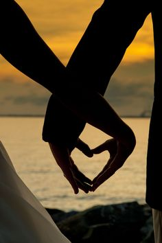 We have done this but with the sunset in the middle of the heart! Makes for such a cute picture!!!