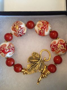 Lampwork and agate with a gold clasp. SOLD