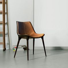 The special edition Langham dining chair features modern curves with mid-century flare. Chair features fiberglass bucket seat construction with cathedral ebony