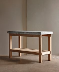 Beautifully smooth marble makes an ideal surface for baking . These tables will look gorgeous in any kitchen as an island or an extra workspace. The base is made of solid oak . Note the shelf below as