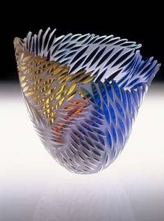 Glass art by Jim Engebretson.  I was given a piece like this when I retired, and I really treasure it!