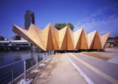 This caterpillar like structure is in Osaka and is a pavilion for a water feature. The point of this is merely aesthetic, while the form is not intentionally useful for anything other than beauty. The material chosen is not one that is usually folded, but the process by which the material is put together creates new ideas of folding.