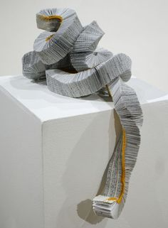 "Susan Porteous, ""Caterpillar"" 2007    Recycled book, linen thread    1¼ x 1½ x 52 inches"
