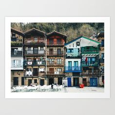 Buy Old buildings in Donibane, Basque country - Travel photography Art Print by cuandovolves. Worldwide shipping available at Society6.com. Just one of millions of high quality products available.