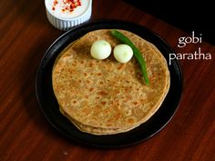 gobi paratha recipe, gobi ka paratha, gobhi paratha with step by step photo/video. cauliflower paratha served with pickle