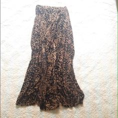 Free people maxi skirt by lovers + friends Burnout velvet leopard print maxi skirt! Looks great with a white distressed tee, or dressed up with a black crop top. Has two slits in front and a built in skirt. Length is 39 1/2 inches. Worn twice. Free People Skirts Maxi